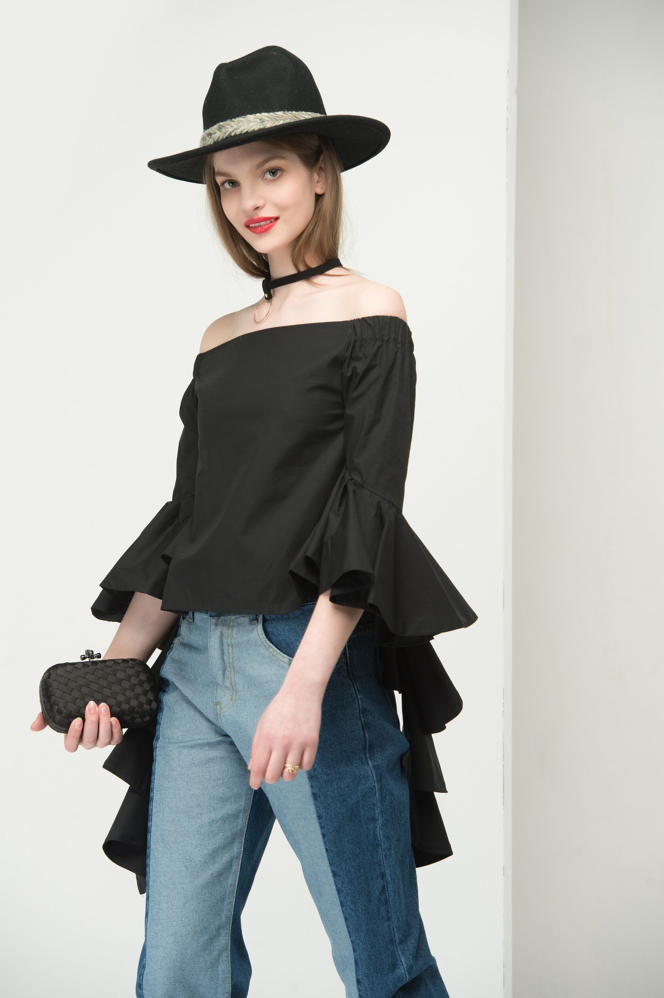 Flared cuff off the shoulder top in black 1