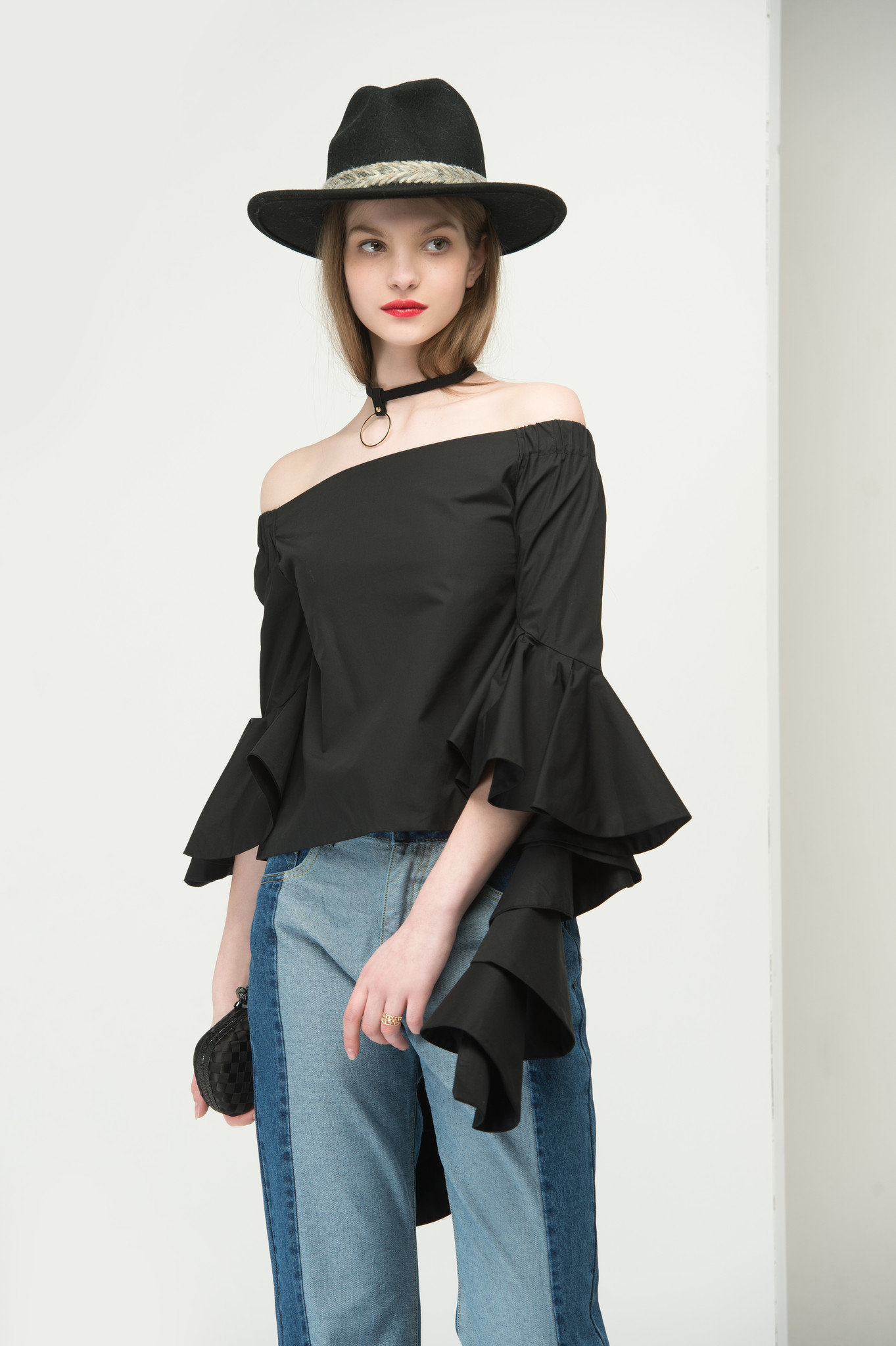 Flared cuff off the shoulder top in black 2